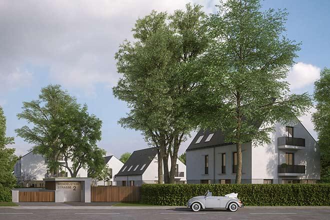 Unter mächtigen Baumkronen liegen bereits die Eingänge des ersten Hauses der exklusiven Architektenhäuser Grünwald. Fotocredit: neubaukompass.de