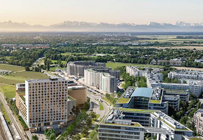 Der 17 Stockwerke hohe Neubau, mit den charakteristischen kreisrunden Fenstern, ermöglicht kurze Wege zu den umliegenden DAX-Unternehmen